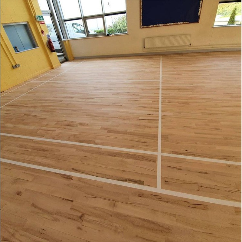 After renovation of solid beech floor in Drumphea National School, County Carlow: reapplied badminton court lines and finished with Junckers Sport HP by AD Sanding & Varnishing, Ireland
