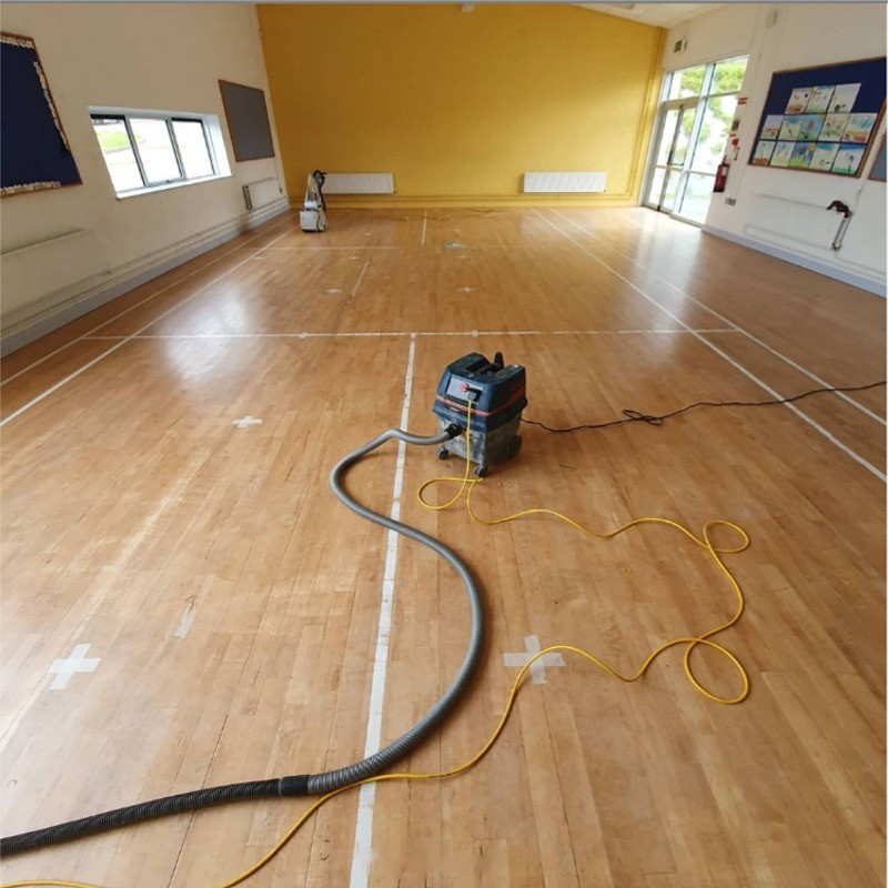 Before makeover of solid beech floor in Drumphea National School, Co. Carlow, Ireland by AD Sanding & Varnishing, Ireland